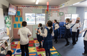 Primary school classroom engaging with EC2D dance tutorial to break up the learning day